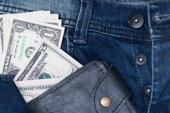 Leather wallet and dollar with the jeans pocket Stock Images