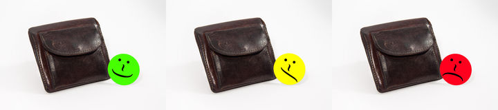 Leather wallet with emoticons showed in three steps royalty free stock photo