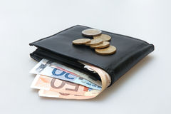 Leather wallet with Euro notes and coins Stock Photo