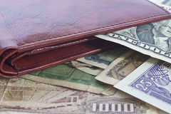 Leather wallet with foreign currency stock photography