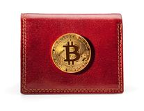 Leather wallet with golden bitcoin coin. Stock Photo