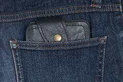 Leather wallet in the jeans pocket Royalty Free Stock Photo