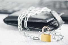 Leather wallet with lock and chain on background computer. Сoncept of protecting electronic money and safety personal finances. S. Ecurity of a financial Royalty Free Stock Photos