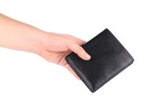 Leather wallet in man hand. Royalty Free Stock Photography