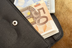 Leather wallet with money Stock Images