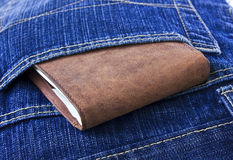 Leather wallet with money in blue jeans. Stock Images