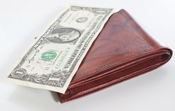 Leather Wallet with One Dollar Bill. A brown leather wallet with a one dollar bill on top, shallow depth of focus on front of wallet Stock Images