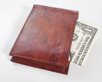 Leather Wallet with One Dollar Bill inside. A brown leather wallet with a one dollar bill inside, focus on front of wallet Royalty Free Stock Images