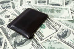 Leather wallet and one hundred dollar bills. Brown, leather wallet and one hundred dollar bills Stock Image