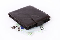 Leather wallet over money. Black leather wallet over euro money, on white background Stock Image
