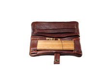 Leather wallet purse. Leather brown pouch purse wallet for weed to carry & roll stock photo