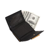 Leather wallet with some dollars inside. Stock Photo