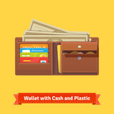 Leather wallet with some money and credit cards Royalty Free Stock Photos