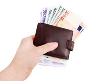 Leather wallets and European Currency, euro. Leather wallets in hand and European Currency, euro ( 50, 100, 500 Royalty Free Stock Photos