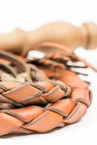 Leather whip isolated over white background closeup macro.  Stock Photo