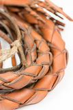 Leather whip isolated over white background closeup macro Royalty Free Stock Photography