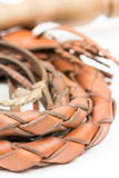 Leather whip isolated over white background closeup macro Royalty Free Stock Image