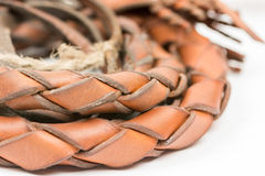 Leather whip isolated over white background closeup macro Stock Photos