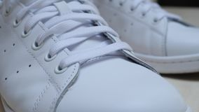 Leather white sneakers with laces