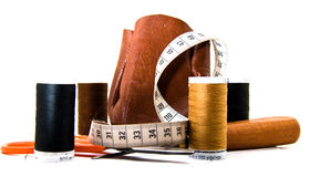 Leather Work. Leather moneybag and the things you need to make it. scissor, measure band and thread Stock Image