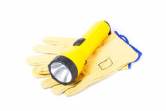 Leather Work Gloves and Flashlight Royalty Free Stock Photography