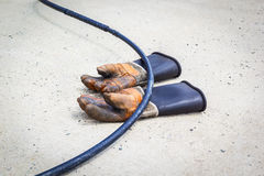 Leather Work Gloves. Old Dirty Leather Work Gloves and electric cable Royalty Free Stock Photos
