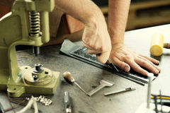 Leather workshop owner. Leather craft workshop owner at his work place Stock Photography