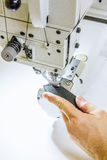 Leather workshop stitching seams on sewing machine Royalty Free Stock Image