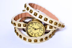 Leather Wrap Watch. Watch with studded leather straps on white background Royalty Free Stock Photography