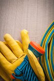 Leather yellow gardening safety glove and hand spraying rubber h Stock Photos