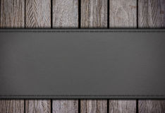 Leatherette on old wood Royalty Free Stock Photos
