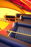 Leatherette seats in a fairground. Leatherette seats of a vintage attraction in a fairground Royalty Free Stock Images