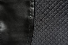 Leatherette sewn to polyester fabric. With relief checks Stock Photography