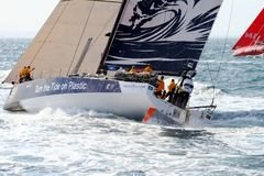 Volvo Ocean Race Team Clean Seas. After leave the city of Alicante teh Ocean 65 sailboats turn the first cape in the race, the Cape of Santa Pola working hard Stock Photos