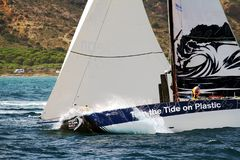 Volvo Ocean Race Team Clean Seas. After leave the city of Alicante teh Ocean 65 sailboats turn the first cape in the race, the Cape of Santa Pola working hard Royalty Free Stock Images