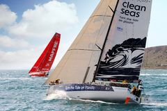 Volvo Ocean Race Team Clean Seas. After leave the city of Alicante teh Ocean 65 sailboats turn the first cape in the race, the Cape of Santa Pola working hard Royalty Free Stock Image