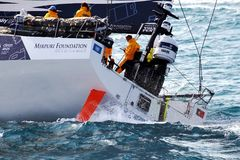 Volvo Ocean Race Team Clean Seas. After leave the city of Alicante teh Ocean 65 sailboats turn the first cape in the race, the Cape of Santa Pola working hard Royalty Free Stock Photo