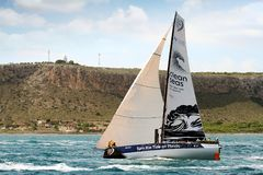 Volvo Ocean Race Team Clean Seas. After leave the city of Alicante teh Ocean 65 sailboats turn the first cape in the race, the Cape of Santa Pola working hard Stock Images