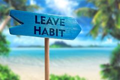 Leave habit sign board arrow. On beach with sunshine background royalty free stock photography