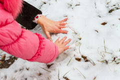 Leave handprints in the snow Stock Photos