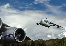 We leave the land-heavy transport aviation of Russia in the sky of Papua New Guinea Stock Photography