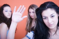Leave me alone. Three woman, leave me alone attitude, focus on the brunette Stock Images