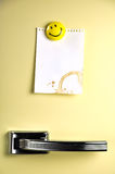 Leave a message on the fridge. Blank note on fifties fridge door, copyspace for message Royalty Free Stock Image