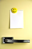 Leave a message on the fridge. Blank note on fifties fridge door, copyspace for message Stock Image