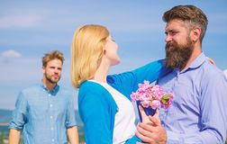 Leave past behind. Couple with bouquet romantic date. Ex husband jealous on background. Couple in love dating outdoor stock photos