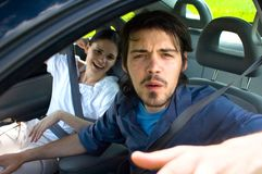Leave Us Alone. A man in a car with his girlfriend telling an unwelcome visitor to leave Stock Images