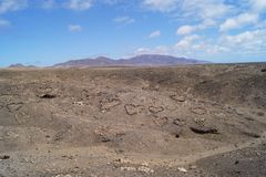 Jandia Fuerteventura Spain Canary Islands. Leave your personal sign of love in the lava fields of Jandia with stones of the volcano and your love will be endless Royalty Free Stock Photos