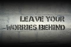 Leave your worries gr. Leave your worries behind stencil print on the grunge white brick wall Royalty Free Stock Image