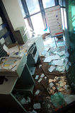 Leaved destroyed office building. This photograph represent an old leave office building with broken glasses and documents on floor stock image
