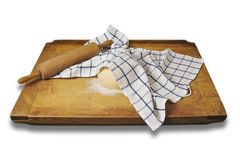 Leavened dough on a  breadboard. With teatowel Stock Photos
